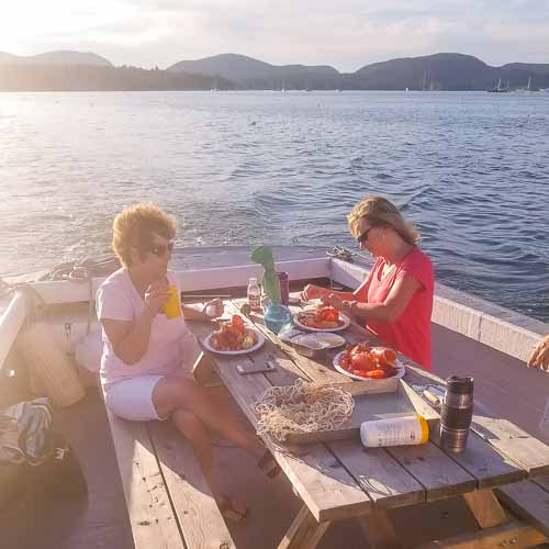 Ladies eating lobster Mount Desert Island